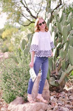 The perfect summer-inspired outfit: Zara Top, Asos Clutch, Levi's Wedgie Icon Jeans, BaubleBar Tassel Earrings, RayBan Clubmasters