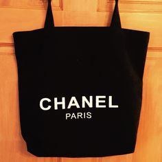 Real Channel Tote Bag It is black and the logo is on both size. I bought it from another poster who received as a gift in the store because a purchase she made so it is 100% real. CHANEL Bags Totes