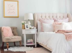 This lush pink bedroom is flushed with soft details including a faux fur rug and light pink headboard