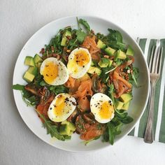 #breakfast salad of @thewealdsmokery smoked salmon soft boiled @gingerpigltd eggs avocado heritage tomatoes @freshandnaked wild rocket topped with @punchfoods chilli smoke seeds drizzled with lime juice & @thegayfarmer olive oil which I bought from @maltbystreet market. Starting the day with plenty of #omega3 fatty acids & #goodfats along with #protein & #nutrients. Always find that this combination along with fibre from vegetables fills me up. Prefer #lowcarbhighfat when not training - lots…