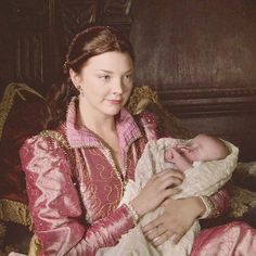 Natalie Dormer as Queen Anne Boleyn holding the baby girl that would become Elizabeth I | The Tudors