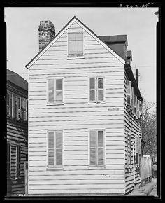 Walker Evans (November 3, 1903 – April 10, 1975)  American photographer and photojournalist:   Frame house. Charleston, South Carolina 1936