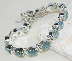 Moonstone bracelet designed and created by Sizzling Silver. Please visit  www.sizzlingsilver.com. Product code: BR-8481