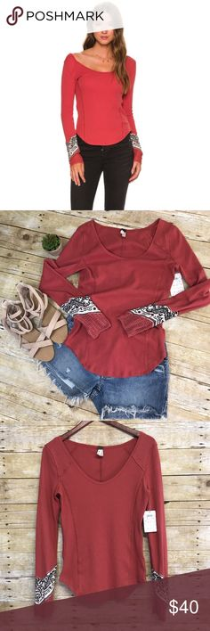 NWT Free People bandana cuff long sleeve-Large NWT Free People long sleeve Henley bandana cuff shirt in rust red. Deep scoop neck and rounded hem. Stock photo color is slightly different- see all pics. Size Large Free People Tops Tees - Long Sleeve