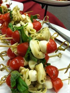 Basil Tortellini Caprese Skewers....perfect party finger food!  (I did them without the tortellini though). They are perfection!!
