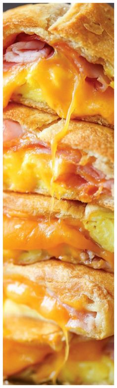 Ham Egg and Cheese Pockets ~ Homemade copycat hot pockets are so easy to make... You can freeze and reheat as needed - for breakfast or late-night cravings!