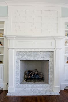 Marble tile, mantel, and insane fretwork (although I am a simpleton and would prob just want to put my tv there)