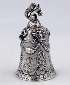 Antique German 800 silver bell cast with rams heads and a three dimensional squirrel as the handle