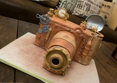 Steampunk Camera Cake - Cake by Tiers Of Happiness Steampunk Theme, Steampunk Wedding, Beautiful Cakes, Amazing Cakes, Gothic Cake, Camera Cakes, Inspired By Charm, Gravity Defying Cake, Cake Logo