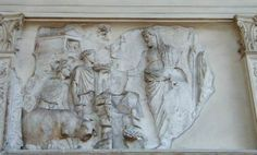 ARA PACIS. Front sculpture panel of Aeneas sacrificing to the household lares/penates.  An animal is being led to sacrifice by a young boy, Aeneas stands opposite clothed in a toga pulled over his head to signify his PIETY.  The shrine to the gods is pictured top left.