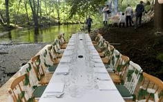 a formal dining table in the woods