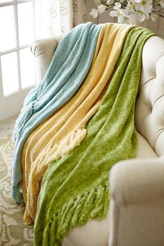 Comfy chenille throws in springtime pastels can help you throw off the last chills of winter.