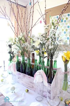 "Table decor ~using open wooden ""tool"" box filled with flowers in bottles"