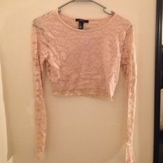 Forever 21 Crop top Beautiful floral, laced, blush crop top. Worn a handful of times but in great condition!  Lace is see through on the arms and through the back of the shirt. Long sleeved. Size medium but can fit a small! Forever 21 Tops Crop Tops