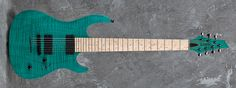Carvin Guitars DC7X, teal on flamed maple (FEL), swamp ash body (ASH), matching flamed maple headstock (FPH), 7 string pointed reverse 3+4 headstock (7PHR), stainless steel jumbo frets (STJF), birdseye maple fingerboard (BMF), abalone dot inlays (ABD), 5 piece maple neck (5MM), Dunlop straplocks (SL), black hardware (BC), black logo (BL)