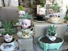 succulents in doll head planters by nadia