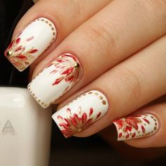 Red, gold and white inspired watercolor nail art. Use the watercolor style in painting the flower petals on your nails. Add dust of gold and beads to enhance the regal effect of this nail art.