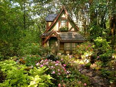 Whimsical Fairy Tale House, Wisconsin Would be great for a child's playhouse in such a nice garden setting.