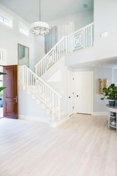 Who wouldn't love to come home to this jaw-dropping entryway? Join us for a Pin Party with #HGTV right now! | Come on in! Entering the home, you're greeted by calming colors throughout. From the light wood floors to the soft blue tones on the wall, coastal has never looked so chic. See more of the foyer >> http://www.hgtv.com/design/hgtv-dream-home/2016/foyer-pictures-from-hgtv-dream-home-2016-pictures?soc=dh16pp