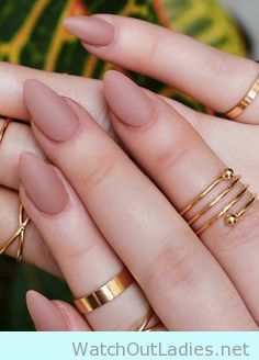 Pink brown coffin nails in matte finish with midi rings