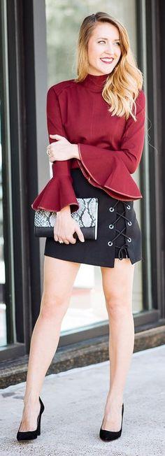 Red Turtleneck Top / Black Laced Up Skirt / Black Pumps / Snake Print Clutch