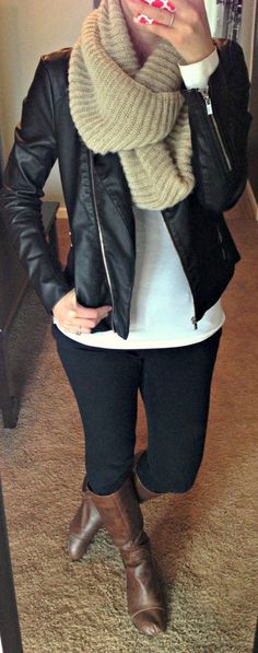 Brown boots, black leather jacket, cream scarf? black jeans, white or grey t-shirt?