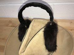 A personal favorite from my Etsy shop https://www.etsy.com/listing/511128966/black-rabbit-fur-ear-ear-warmers
