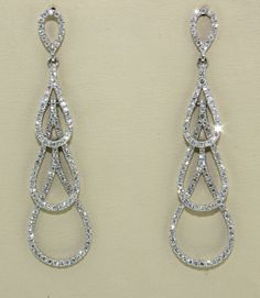 On the seventh day of Christmas my true love gave to me...seven swans a-swimming!  You'll be elegant like a swan in these exquisite diamond drop earrings - they are a real show stopper! #12daysofsparkle