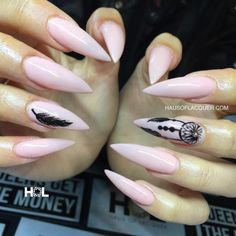 Light pink stiletto nails with feather design