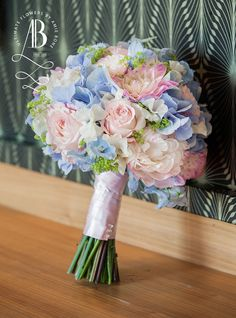 Delicate pastel pinks and blues bridal bouquet.  Featuring hydrangeas, blush roses, stocks and peonies