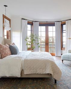 Eclectic elegance achieves the ultimate getaway vibe at this Marin mountain home, designed by Katie Monkhouse Interiors. Get the look at theshadestore.com. Master Bedroom Design, Bedroom Inspo, Dream Bedroom, Bedroom Decor, Bedroom Inspiration, Bedroom Ideas, Bedroom Balcony, Bedroom Windows, Interior Desing