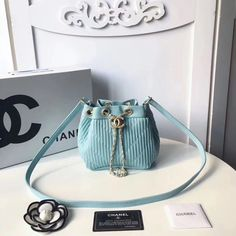 Chanel woman mini bucket bag stripes style original leather version