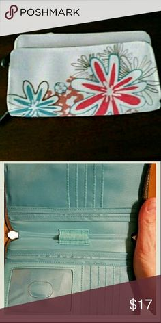 Thirty-one Free To Be wallet New without packaging. Only used for display. Lots of slots for cards and ??????. Cute spring pattern. Works well with many colors. Thirty-one  Bags Clutches & Wristlets