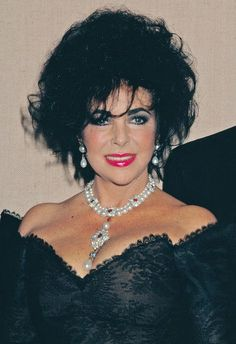 Elizabeth Taylor's pearl, diamond, and ruby necklace and matching earrings were…