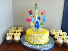 Sponge Bob cake with matching cupcakes. Designed & decorated by Anna Hernandez & Christina Barrett of The Pink Bakery Box.