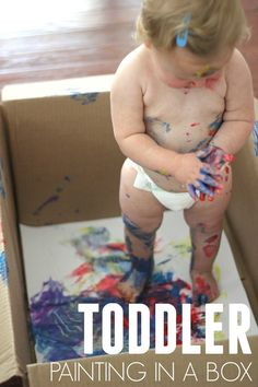 Toddler Painting in a Box! Such a fun sensory experience.