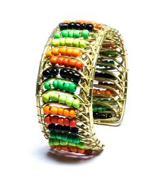 This Beads And Metal Bracelet bracelet, is beautifully crafted with multicolour beads. This colourful piece is bracelet can be matched with many with any casual wear.