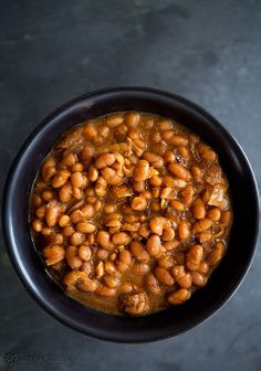 Slowly Cooker Boston Baked Beans ~ white beans cooked with salt pork and onions, in a molasses and mustard sauce. | SimplyRecipes.com