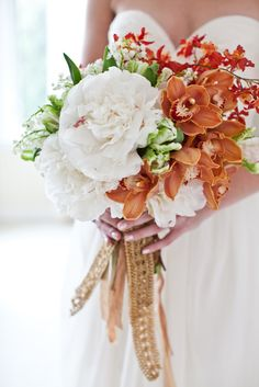 What a beautiful and unique combo of colors and flowers.. gorgeous bouquet!