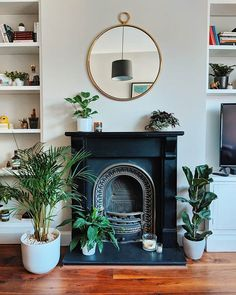 Victorian Fireplace with grey walls and circular mirror - Modern Design Empty Fireplace Ideas, Brick Fireplace Makeover, Fireplace Design, Unused Fireplace, Living Room Interior, Home Living Room, Living Room Designs, Living Room Decor, Bedroom Decor