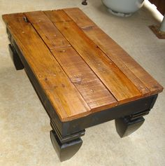 Used scrap pieces from a pallet & fence post finials for the feet to make a cute footstool/ bench