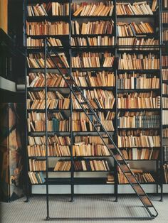 Bookcase formed in industrial iron and timber. books are stacked two shelves deep, and the staggared cases allow access to back shelf books.   Maison de Verre' was built from 1928 to 1932 in Paris.  Design was a collaboration amount Pierre Chareau, Bernard Bijvoet and Louis Dalbet.