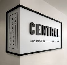 "Something like this, but not wrapped around the wall....black frame with modern lettering ""Kithkin Real Estate"""