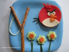 Red Angry Bird Lunch: she uses cheese colored red, but I think a slice of salami would be easier!