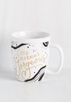 You once thought coffee was the perfect pick-me-up, but after starting your morning with the honeyed greeting gilding this ceramic mug, you insist compliments are the chief energizer! Sip any ol' bevvie out of this black-swirled cup and you'll be motivated to make today the best ever.