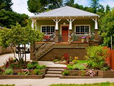 Exterior Of A Cottage Home With Front Porch And Decorative Tapered Columns
