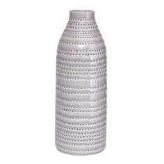 The simple and elegant Circles vase by House Doctor is made of glazed faience with a minimalistic embossed pattern in light grey. The vase looks great with a single flower or branch and is easy to mix and match with other interior decorations from House Doctor!
