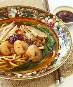 Delicious Hokkien Hae Mee (Prawn Noodles) in a spicy and flavorful broth served with shrimps, slices of pork, bean sprouts, and water spinach.