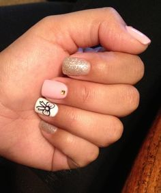 Gel nails with bow design.
