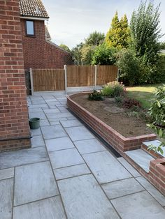 Patio laid using silver grey sandstone and wall built using red brick . Brick Wall Gardens, Brick Garden, Family Garden, Home And Garden, Red Brick Walls, Grey Gardens, Brick Patios, Extension Ideas, Red Bricks